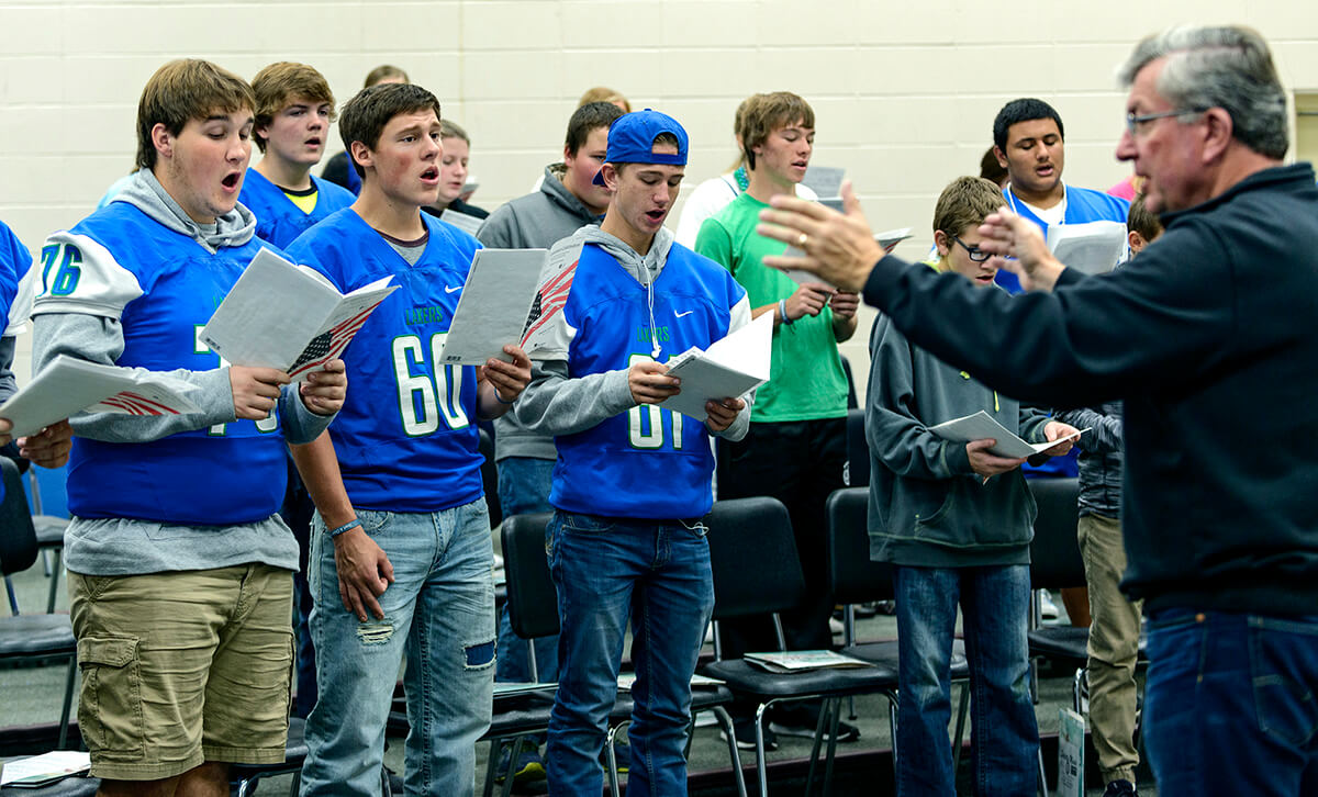 Gordy Moeller directing choir