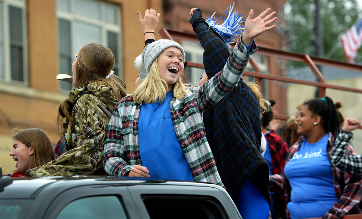 Minnewaska Area students riding on a float for pep rally