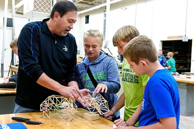 Minnewaska area students building with teacher
