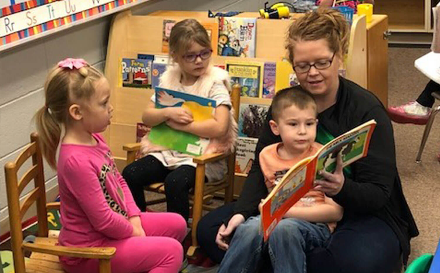 Minnewaska area preschool students reaching with their teacher