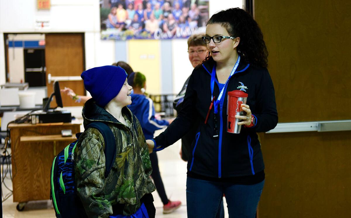 Minnewaska Area Schools staff greets a student